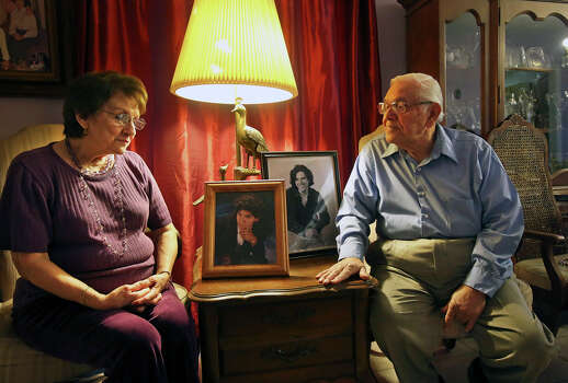 Eddie and Minnie Alejandro reflect on their son David's life Saturday, March 15, 2014 before his killer is to be put to death this week for the murder which occurred 15 years ago. Photo: TOM REEL, San Antonio Express-News / San Antonio Express-News
