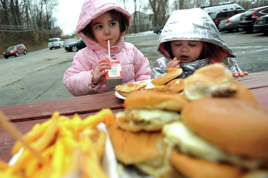 Friends Sophie Ring, 3, of Wynantskill, left, and Rosemary Rivet, 2, of West Sand Lake eat lunch on Wednesday, March 19, 2014, at Jack's Drive In in Wynantskill, N.Y. The drive-in's opening signals the start of spring. (Cindy Schultz / Times Union) Photo: Cindy Schultz / 00026205A