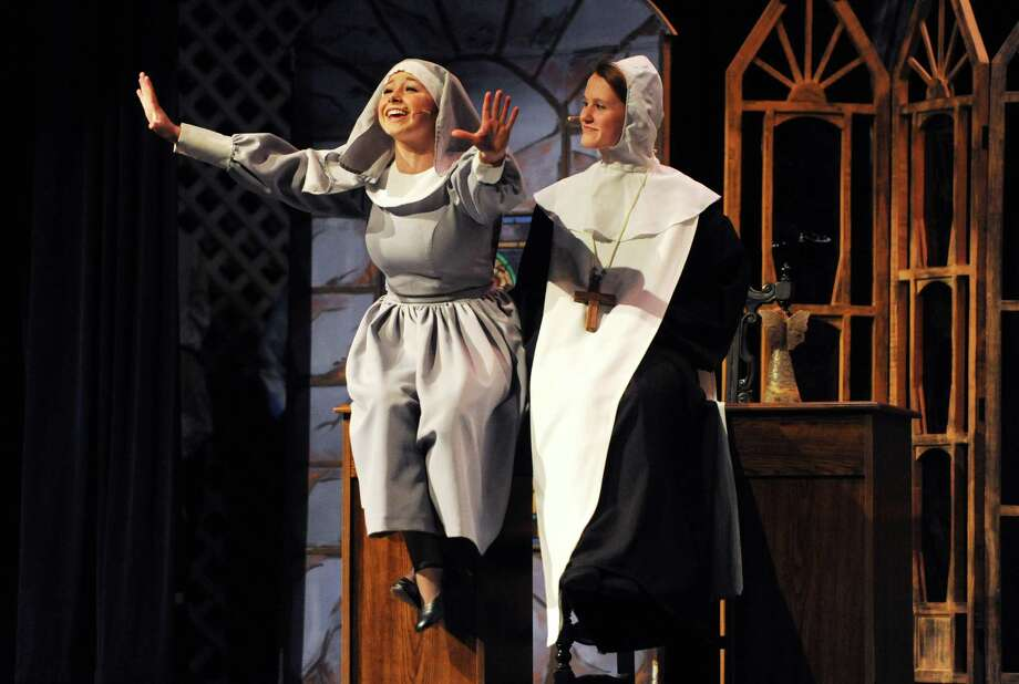 "Jessica Schwartz, left, playing Maria, and Marissa Detlor, playing Mother Abbess, act out a scene during the final dress rehearsal of ""The Sound of Music"" at Brookfield High School in Brookfield, Conn. Wednesday, March 19, 2014.  The musical is directed by John LaMendola and stars Jessica Schwartz playing the lead role of Maria.  Performances will take place Thursday, March 20 at 7 p.m., Friday at 7 p.m., Saturday at 1 p.m. and 7:30 p.m., and Sunday at 1 p.m.  Tickets are $15 for adults and $10 for students, seniors and faculty members.  Children 5 and under are admitted for free. Photo: Tyler Sizemore / The News-Times"