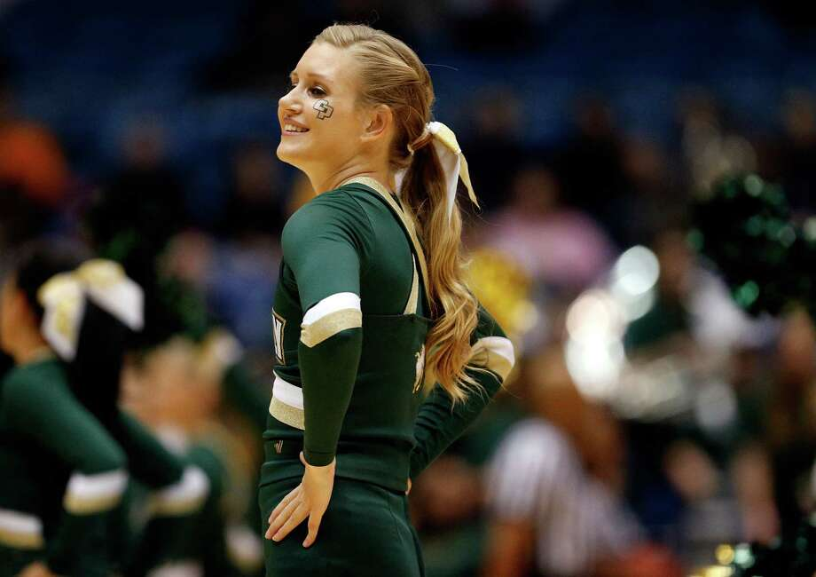DAYTON, OH - MARCH 19:  A Cal Poly Mustangs cheerleader performs during the first round of the 2014 NCAA Men's Basketball Tournament against the Texas Southern Tigers at UD Arena on March 19, 2014 in Dayton, Ohio. Photo: Gregory Shamus, Getty Images / 2014 Getty Images
