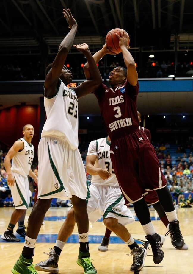 First round March 19: No. 16 Cal Poly 81, No. 16 TSU 69 Madarious Gibbs #3 of Texas Southern goes up for a shot as Joel Awich #25 of Cal Poly defends. Photo: Gregory Shamus, Getty Images