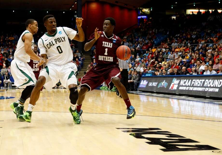 D.D. Scarver #1 of Texas Southern carries the ball as Dave Nwaba #0 of Cal Poly defends. Photo: Gregory Shamus, Getty Images
