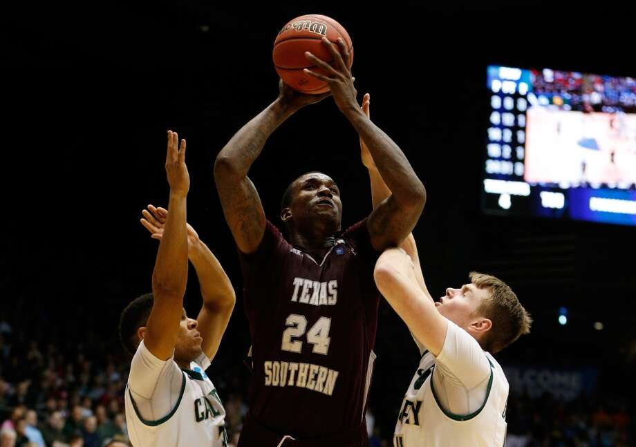 Aaric Murray #24 of Texas Southern goes up for a shot as Kyle Odister #35 and Zach Gordon #44 of Cal Poly defend. Photo: Gregory Shamus, Getty Images