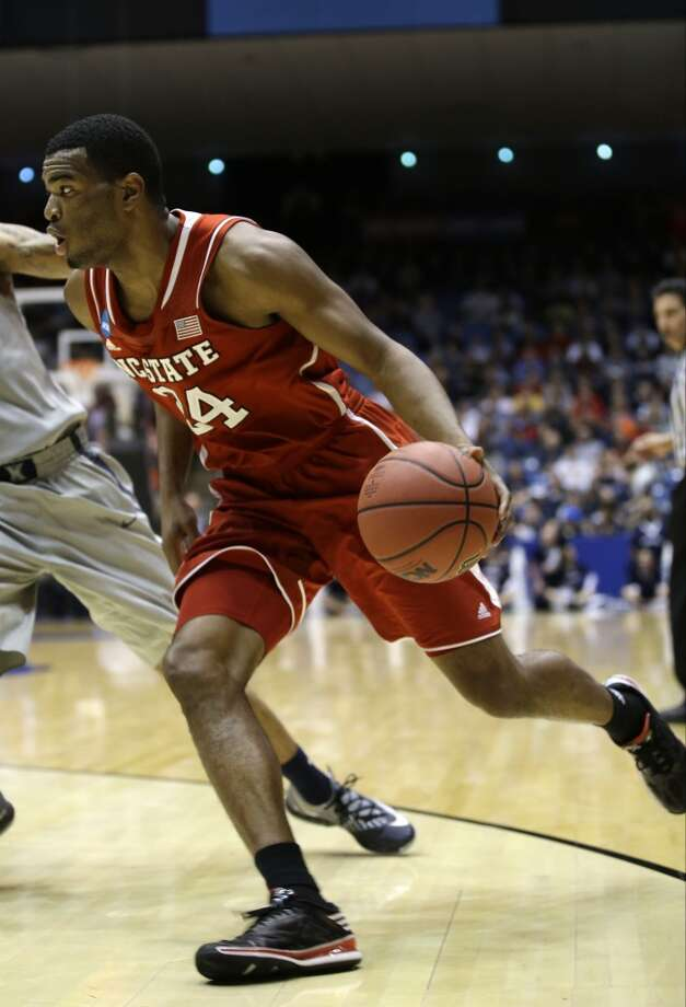 North Carolina State forward T.J. Warren dribbles against Xavier. Photo: Al Behrman, Associated Press