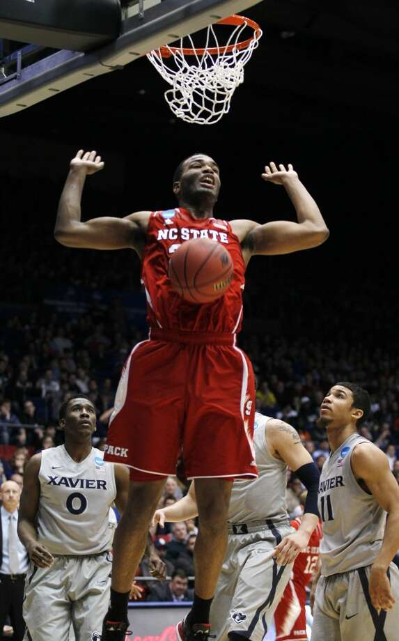 North Carolina State forward T.J. Warren dunks against Xavier. Photo: Skip Peterson, Associated Press