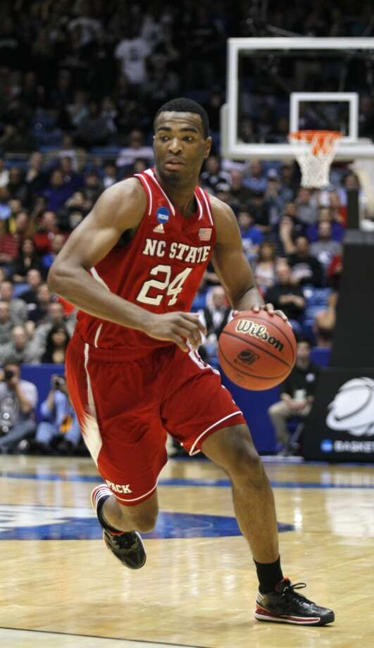 North Carolina State forward T.J. Warren drives against Xavier. Photo: Skip Peterson, Associated Press