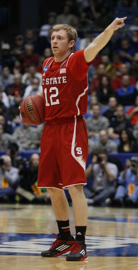 North Carolina State guard Tyler Lewis calls a play against Xavier. Photo: Skip Peterson, Associated Press