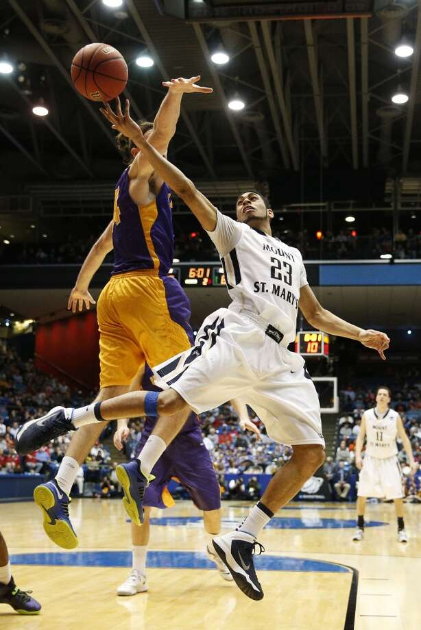First round March 18: No. 16 Albany 71, No. 16 Mount St. Mary's 64  Julian Norfleet of Mount St. Mary's shoots against John Puk of Albany. Photo: Gregory Shamus, Getty Images