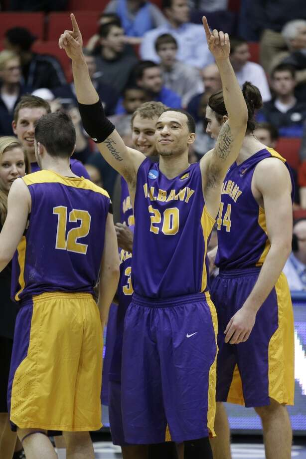 Albany forward Gary Johnson (20) celebrates after they defeated Mount St. Mary's. Photo: Al Behrman, Associated Press