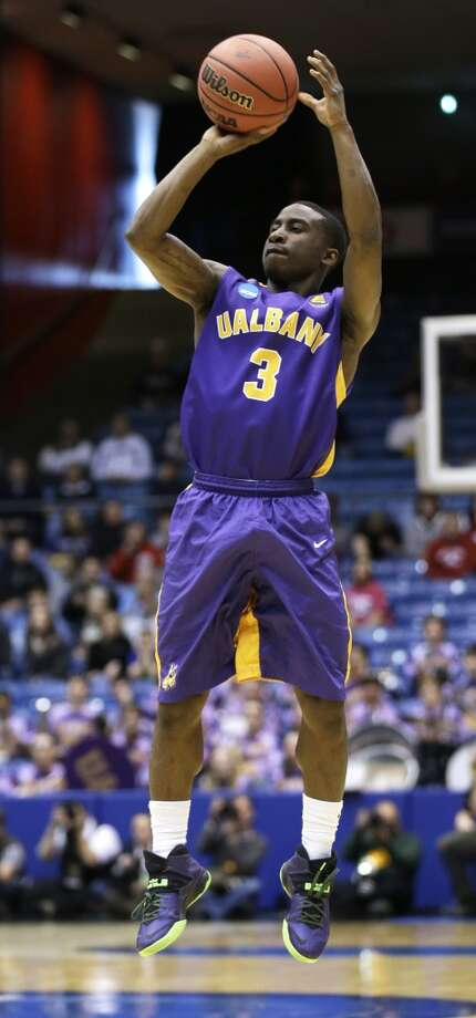 Albany guard DJ Evans shoots against Mount St. Mary's. Photo: Al Behrman, Associated Press