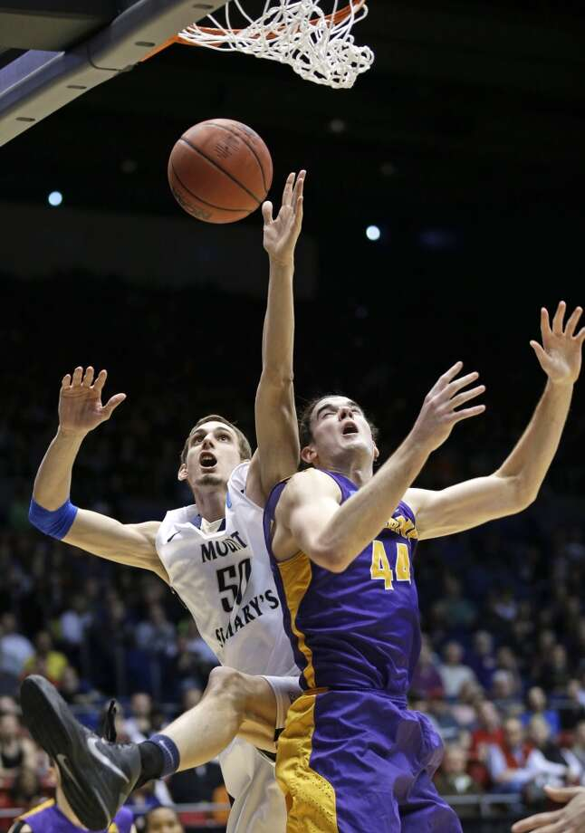 Mount St. Mary's center Taylor Danaher (50) goes up for a rebound against Albany center John Puk (44). Photo: Al Behrman, Associated Press