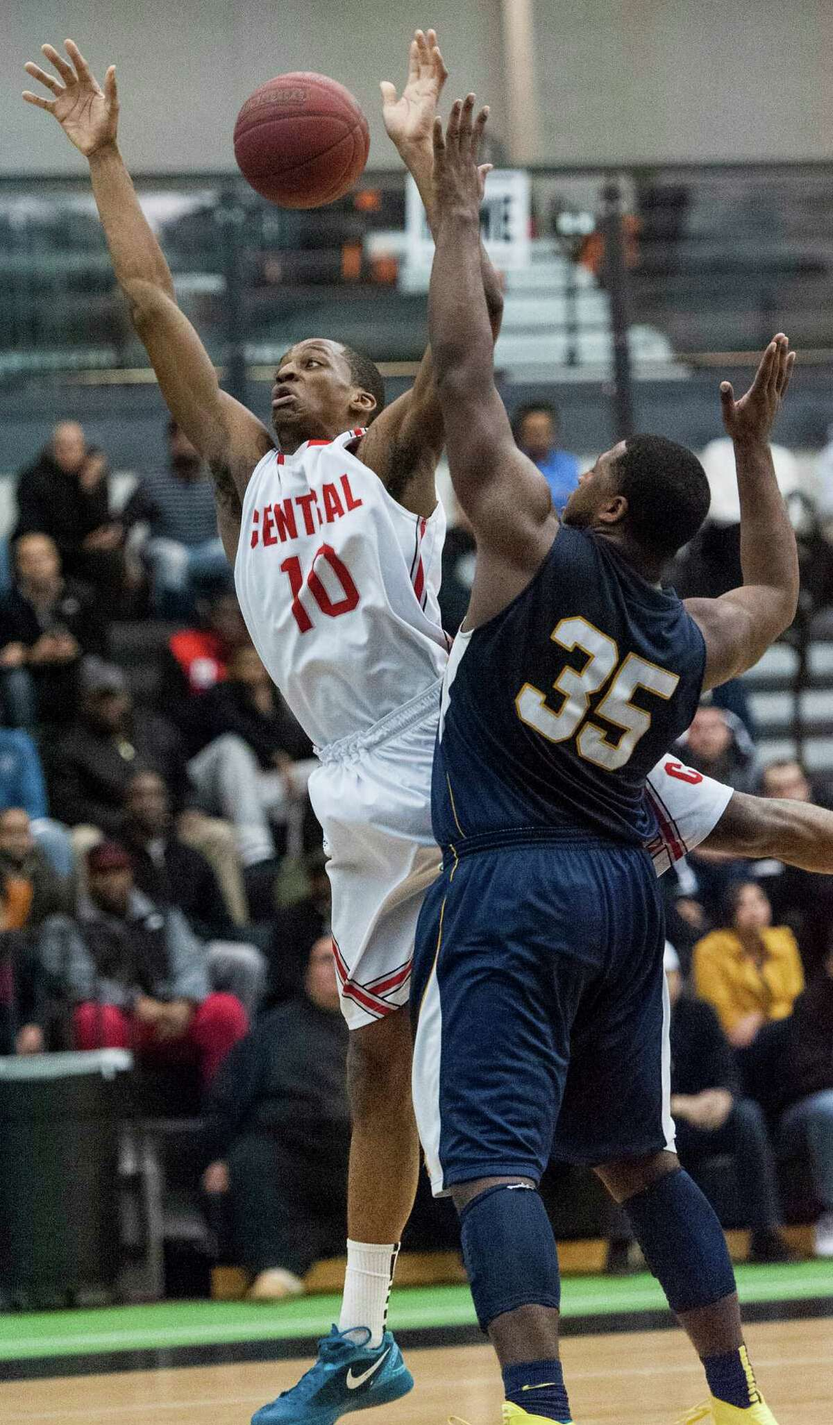 Bridgeport Central high school's Sha'quan Bretoux and Ledyard high school's Darnay Gray go after a loose ball during a CIAC class LL semifinal boys basketball tournament game played at the Floyd Little Athletic Center, New Haven, CT on Wednesday, March, 19th, 2014