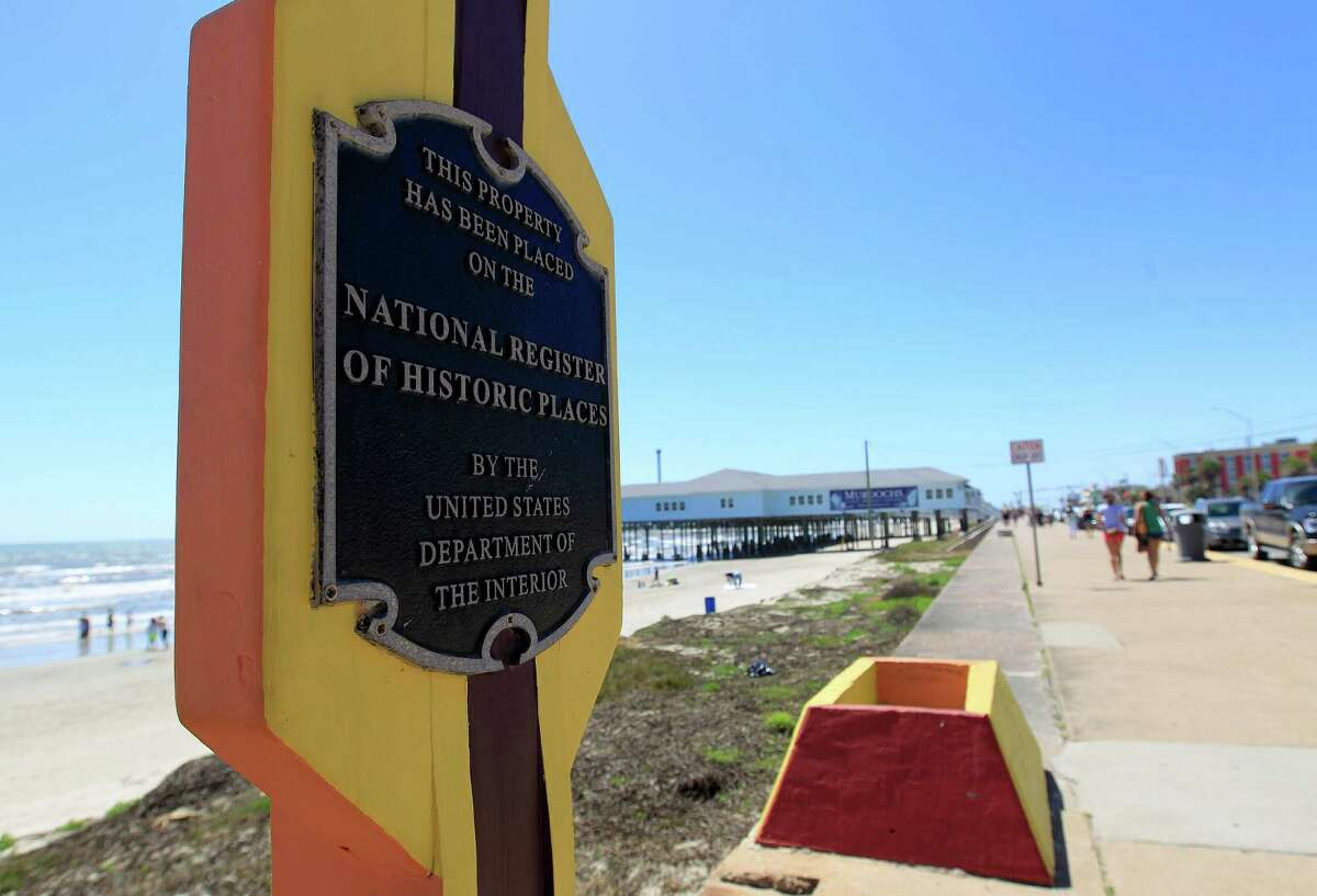 A sign declaring that the site of the Balinese Room pier was placed on the National Register of Historic Places on the Seawall, Tuesday, March 18, 2014, in Galveston.