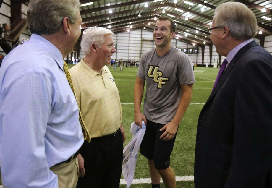 Blake Bortles shares a laugh with UCF head football coach George O'Leary following his pro-day workout at the Nicholson Field House at UCF in Orlando, Fla. Wednesday, March 19, 2014. (Gary W. Green/Orlando Sentinel) Photo: Orlando Sentinel