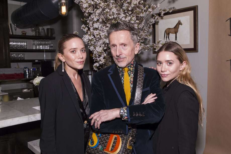 Mary-Kate and Ashley Olson with Simon Doonan, Barneys Creative Ambassador-at-Large. Photo: Claudine Gossett, Drew Altizer Photography