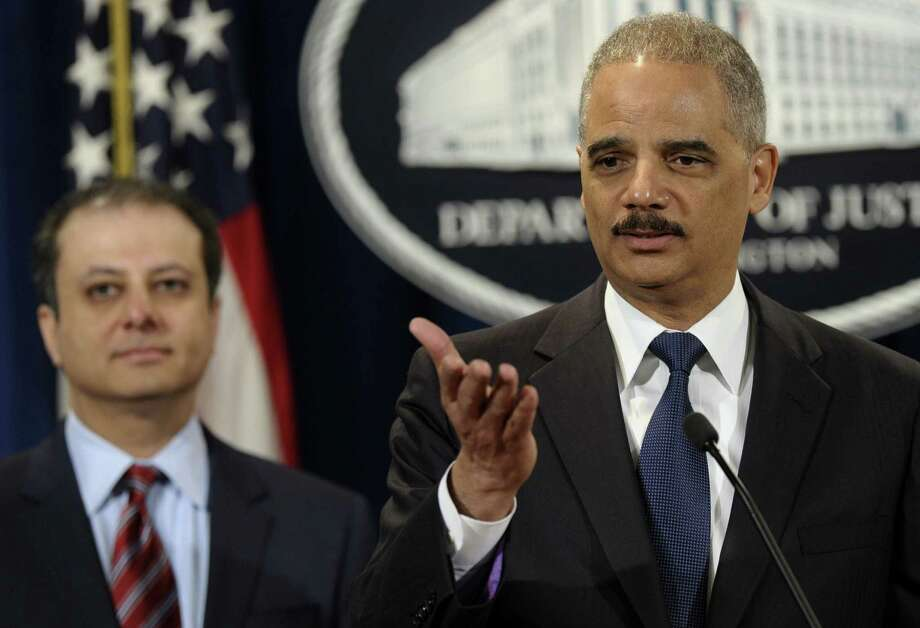 Attorney General Eric Holder, accompanied by Preet Bharara, the U.S. attorney in Manhattan who led the investigation of Toyota, announces the $1.2 billion settlement with the company. Photo: Susan Walsh / Associated Press / AP