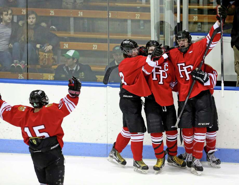 Fairfield Prep celebrate with team mate #22 Dean Lockery after Lockery first period action goal during Wednesday evening CIAC Division I Semi-Finals against Notre Dame of West Haven. Photo: Mike Ross / Mike Ross Connecticut Post freelance -www.mikerossphoto.com