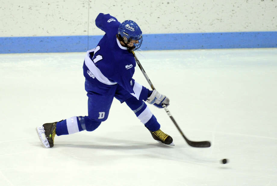 Darien's Nicholas Tuzinkiewicz sends the puck down ice Wednesday, Mar. 19, 2014, during the boys ice hockey Division I semifinals against Notre Dame-Fairfield at Ingalls Rink in New Haven, Conn. Photo: Autumn Driscoll / Connecticut Post