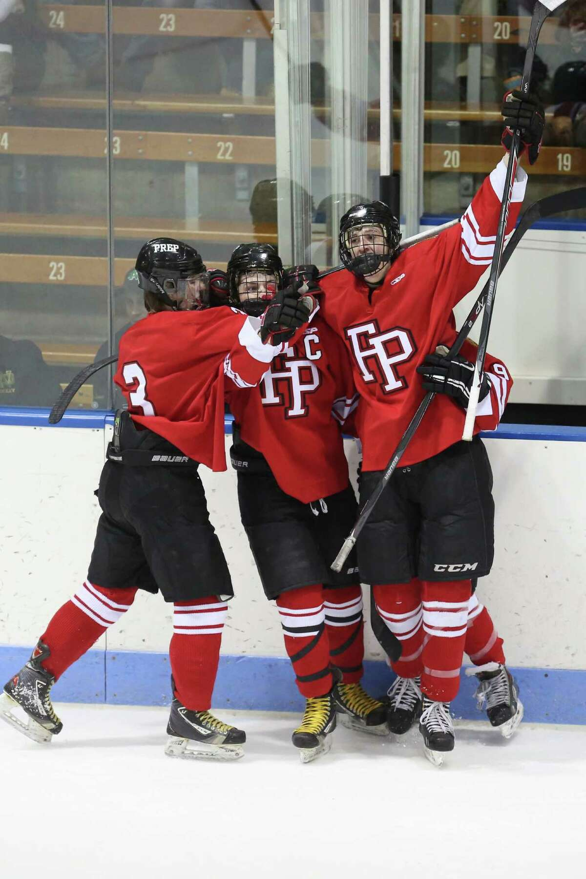 Fairfield Prep celebrate with team mate #22 Dean Lockery after Lockery's first period action goal during Wednesday evening CIAC Division I Semi-Finals against Notre Dame of West Haven.