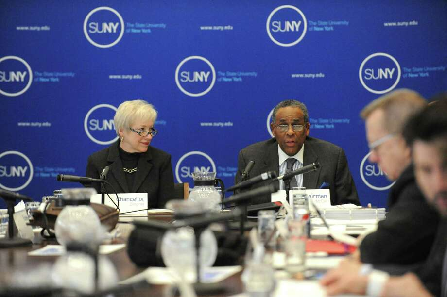 Nancy L. Zimpher, SUNY Chancellor, left, and H. Carl McCall, Chairman of the State University of New York Board sit at the head of the SUNY board meeting to vote on the breakup of NanoCollege from UAlbany Wednesday March 19, 2014, at the SUNY Central Administration Building in Albany, N.Y. The NanoCollege breakup would create a new marriage of SUNYIT in Utica-Rome with Nano to be called State University of New York Institute of Nanoscale Science, Engineering and Technology.  (Michael P. Farrell/Times Union) Photo: Michael P. Farrell / 00026210A