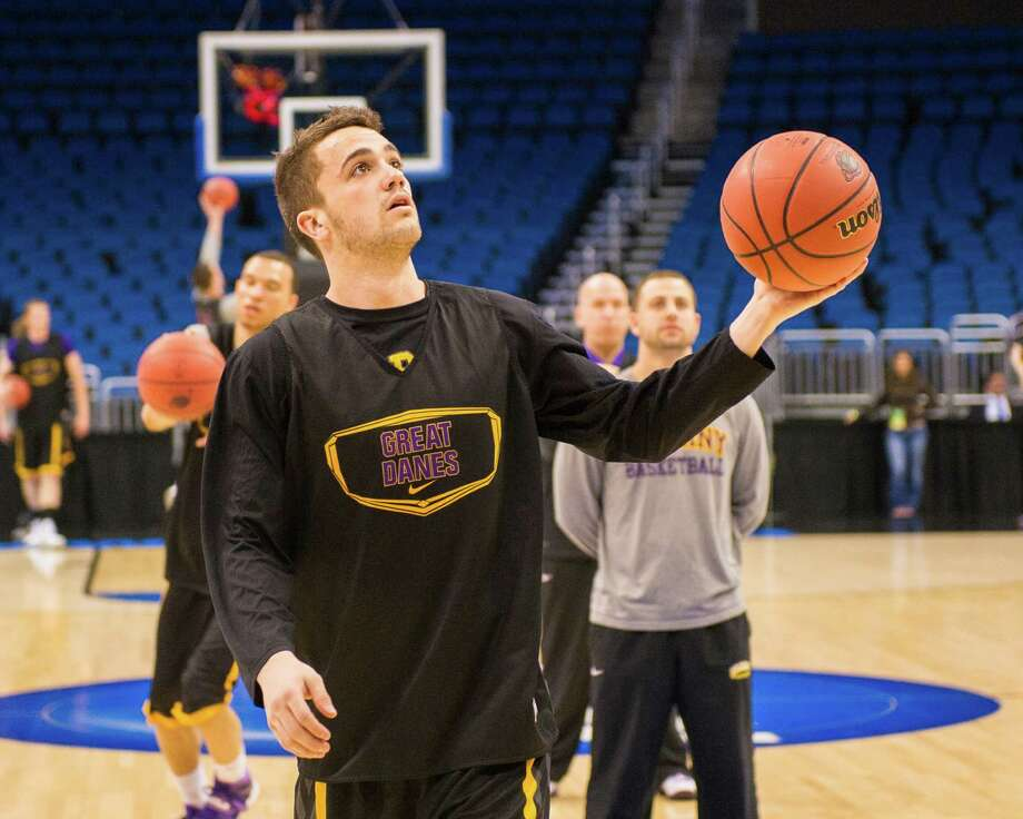 UAlbany Great Danes guard Peter Hooley (12) rebounds the ball during the NCAA Second Round practice session, Wednesday evening, March 19, 2014, in Orlando, FLA. (Gregory Fisher/Special to the Times Union) Photo: GF / SportsThroughTheLens.com