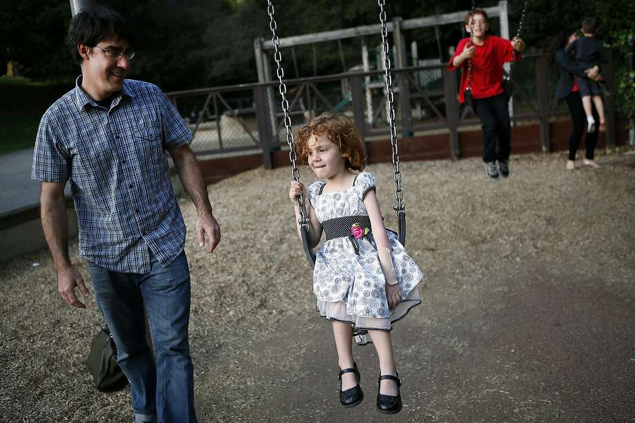 Sofia Jarvis, 4, plays at a Berkeley park with her dad, Jeff Jarvis, and brother Jack, 8. Sofia has lost movement in her left arm. Photo: Michael Short, The Chronicle