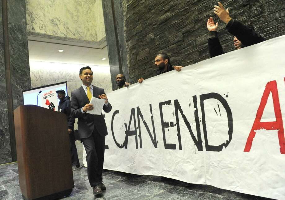 Health Department Commissioner Nirav Shah speaks at a rally on ending AIDS in New York Wednesday morning, March 19, 2014, in the well of the Legislative Office Building in Albany, N.Y. (Michael P. Farrell/Times Union) Photo: Michael P. Farrell / 00026209A