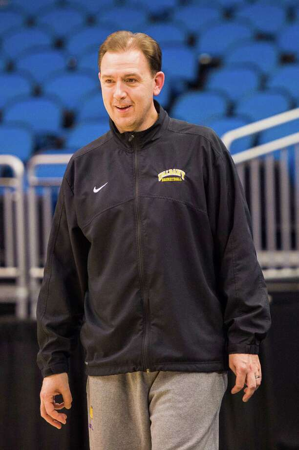 UAlbany Great Danes head coach Will Brown was in good spirits during the NCAA Second Round practice session, Wednesday evening, March 19, 2014, in Orlando, FLA. (Gregory Fisher/Special to the Times Union) Photo: GF / SportsThroughTheLens.com