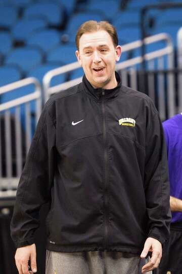 UAlbany Great Danes head coach Will Brown is loose and in good spirits during the NCAA Second Round
