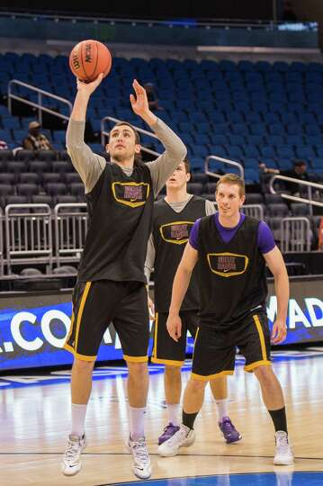 UAlbany Great Danes guard Peter Hooley (12) takes a practice jump shot with UAlbany Great Danes forw