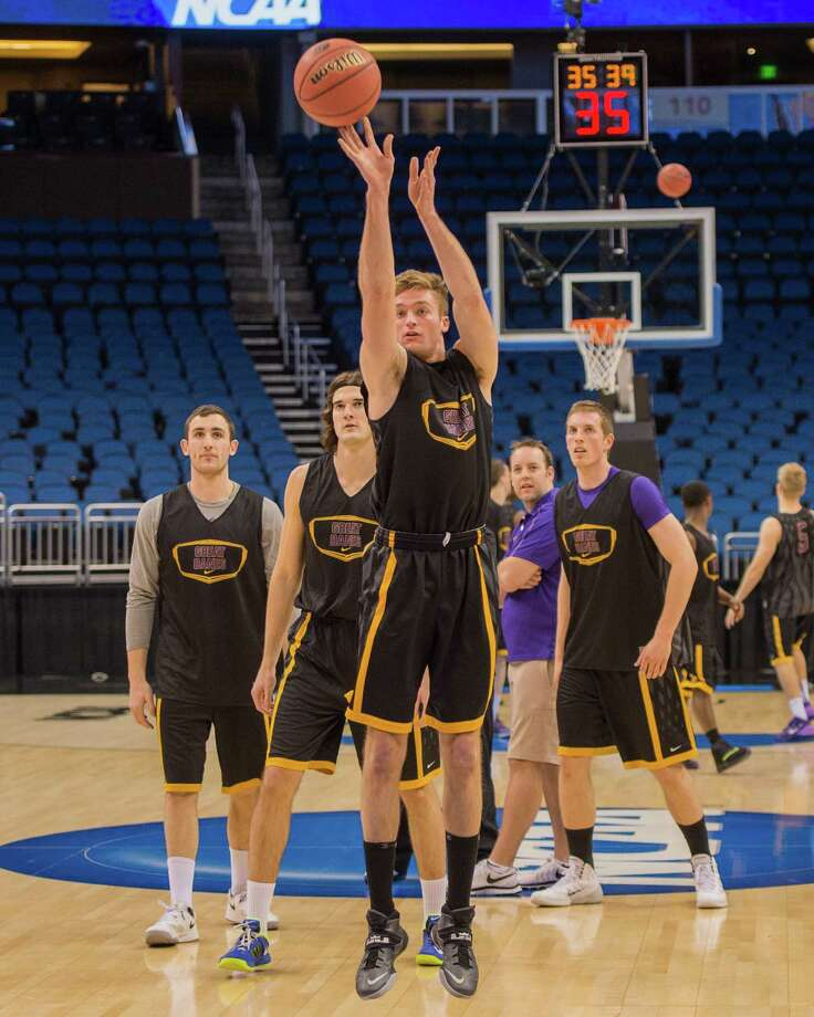 UAlbany Great Danes forward David Wiegmann (22) takes a practice shot from the top of the key with UAlbany Great Danes forward Sam Rowley (14), UAlbany Great Danes center John Puk (44), UAlbany Great Danes assistant coach Jeremy Friel, and UAlbany Great Danes forward Luke Devlin (11)  left to right during NCAA first round practice session, Wednesday evening, March 19, 2014, in Orlando, FLA. (Gregory Fisher/Special to the Times Union) Photo: GF / SportsThroughTheLens.com