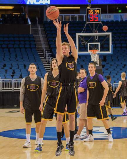 UAlbany Great Danes forward David Wiegmann (22) takes a practice shot from the top of the key with U