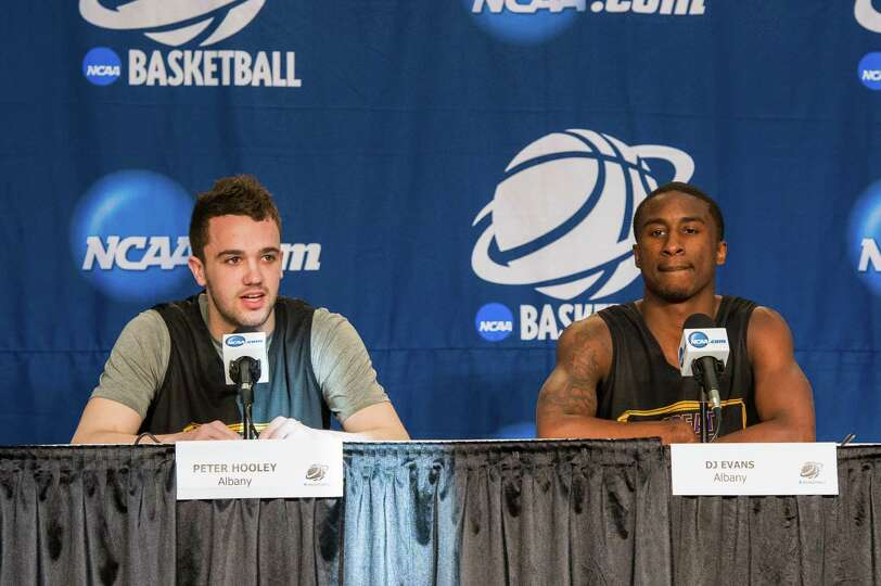 UAlbany Great Danes guard Peter Hooley (12) left  and UAlbany Great Danes guard DJ Evans (3) right a