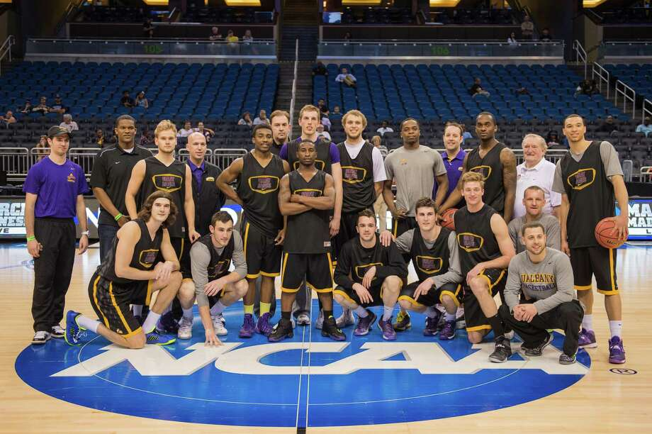 The UAlbany Great Danes Mens Basketball Team pose at center court after their NCAA Second Round practice session, Wednesday evening, March 19, 2014, in Orlando, FLA. (Gregory  Fisher/Special to the Times Union) Photo: GF / SportsThroughTheLens.com
