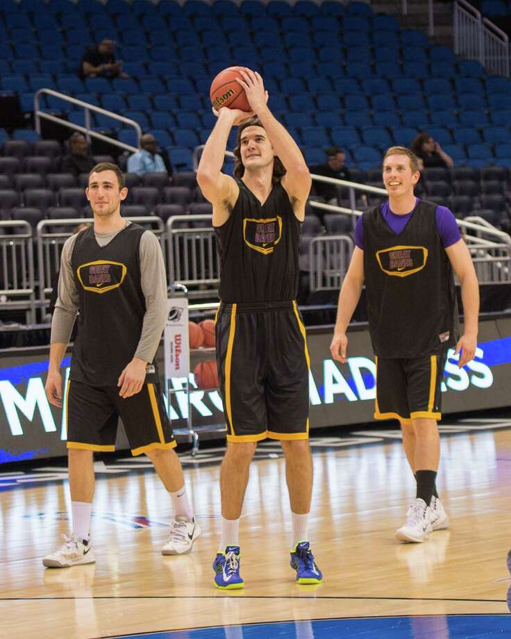 UAlbany Great Danes forward Sam Rowley (14) left, UAlbany Great Danes forward Levan Shengelia (4) center, and UAlbany Great Danes forward Luke Devlin (11) right take turns taking shots during the NCAA Second Round practice session, Wednesday evening, March 19, 2014, in Orlando, FLA. (Gregory Fisher/Special to the Times Union) Photo: GF / SportsThroughTheLens.com
