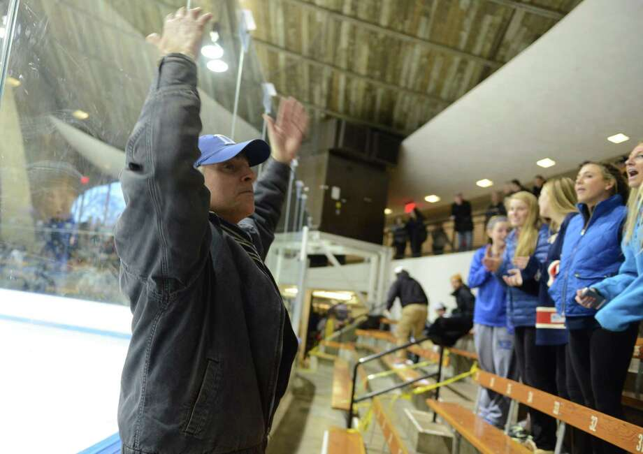 Fans cheer on Darien Wednesday, Mar. 19, 2014, during the boys ice hockey Division I semifinals against Notre Dame-Fairfield at Ingalls Rink in New Haven, Conn. Photo: Autumn Driscoll / Connecticut Post