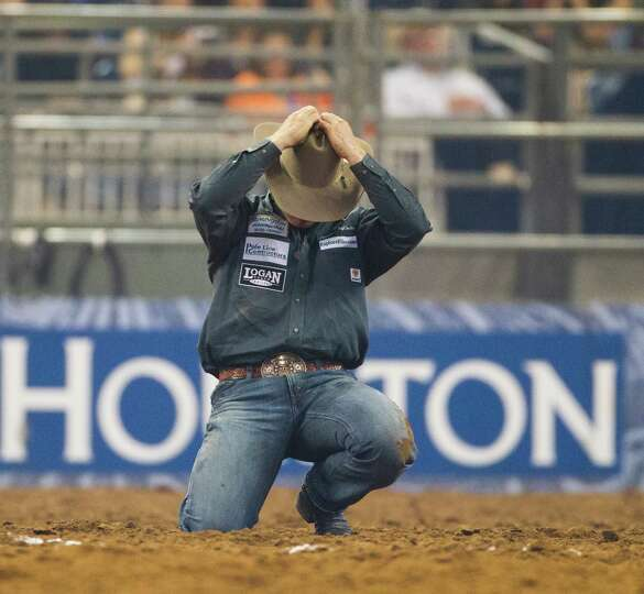 Dakota Eldridge reacts after losing the BP Super Series Semifinal 1 steer wrestling competition, Wed