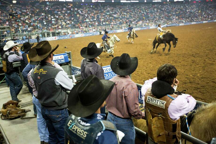 Bareback riders watch as a rider competes on the BP Super Series Semifinal 1bareback riding competition during the Houston Livestock Show and Rodeo, Wednesday, March 19, 2014, in Houston. Photo: Marie D. De Jesús, Houston Chronicle / © 2014 Houston Chronicle