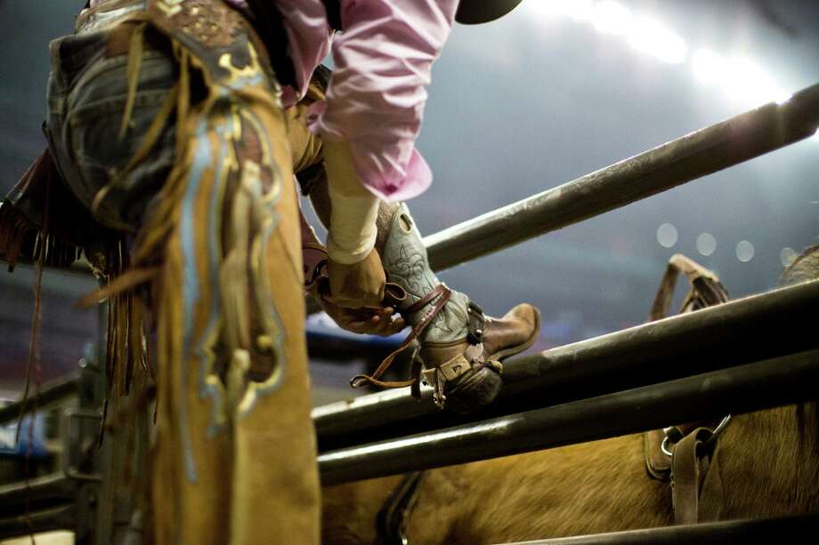 A bareback rider gets ready to compete on the BP Super Series Semifinal 1 RodeoHouston, Wednesday, March 19, 2014, in Houston. Photo: Marie D. De Jesús, Houston Chronicle / © 2014 Houston Chronicle