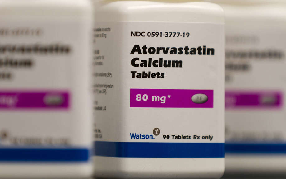 Under the new guidelines, half of Americans age 40 to 75 would quality to be considered for cholesterol-lowering statin drugs, such as this generic form of Lipitor. Photo: Associated Press / File Photo / Watson Pharmaceuticals Inc.