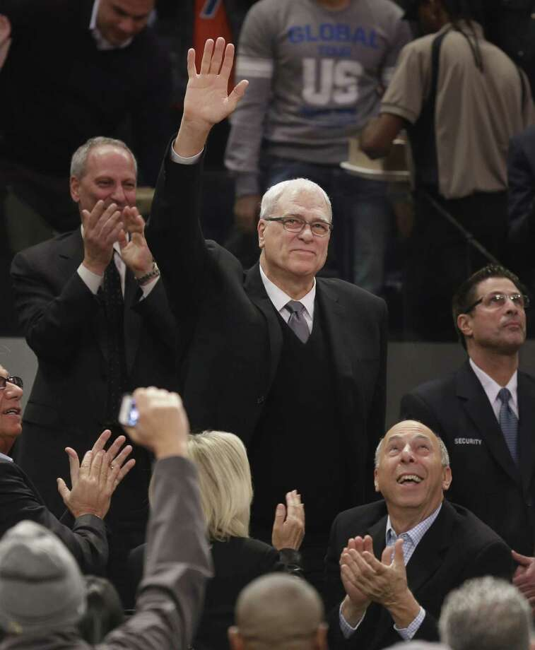 Phil Jackson waves to the crowd as he is introduced during the first half of an NBA basketball game between the New York Knicks and the Indiana Pacers at Madison Square Garden on Wednesday, March 19, 2014, in New York. Jackson was hired as the president of the Knicks this week. (AP Photo/Seth Wenig) ORG XMIT: NYSW106 Photo: Seth Wenig / AP