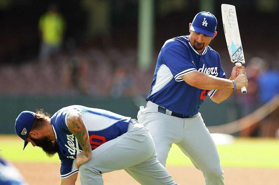 The Dodgers' Adrian Gonzalez stands ready with a cricket bat as Brian Wilson stretches in Sydney. Los Angeles and Arizona begin the regular season with two games there this weekend. Photo: Brendon Thorne / Getty Images / 2014 Getty Images