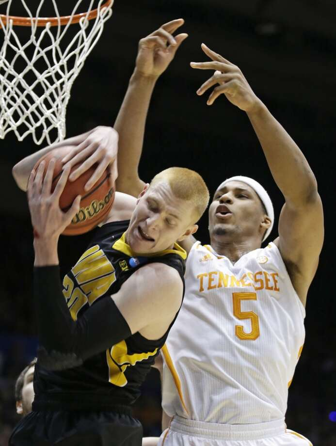 First round March 19: No 11 Tennessee 78, No. 11 Iowa 65 (OT) Iowa forward Aaron White, left, pulls a rebound away from Tennessee forward Jarnell Stokes (5). Photo: Al Behrman, Associated Press