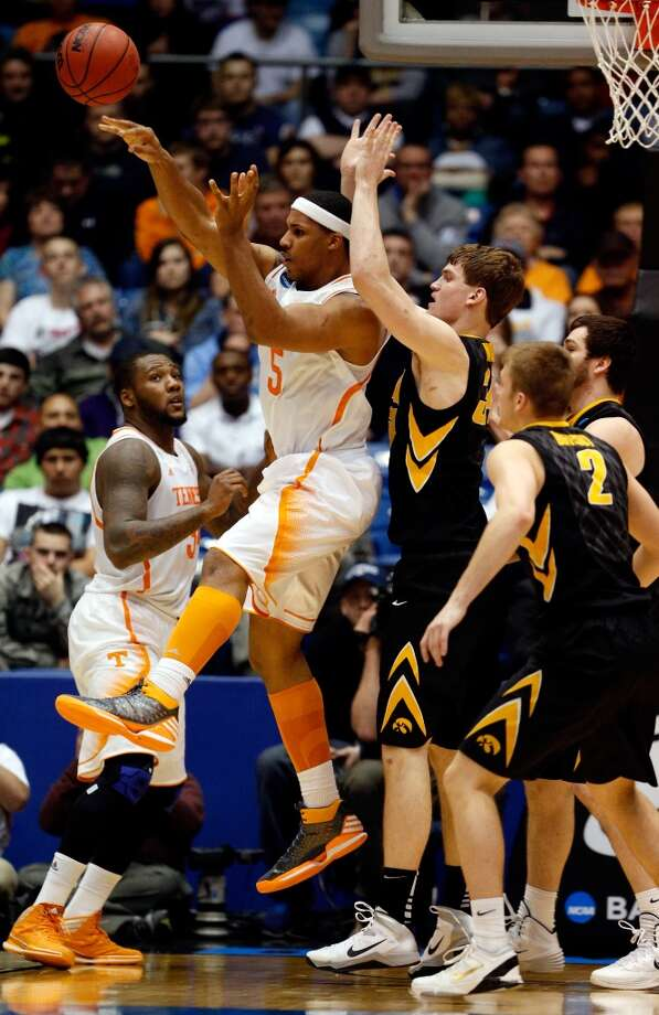 Jarnell Stokes #5 of Tennessee passes as Adam Woodbury #34 of Iowa defends. Photo: Gregory Shamus, Getty Images