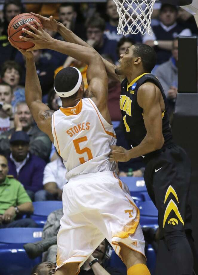Tennessee forward Jarnell Stokes (5) is fouled by Iowa forward Melsahn Basabe. Photo: Al Behrman, Associated Press