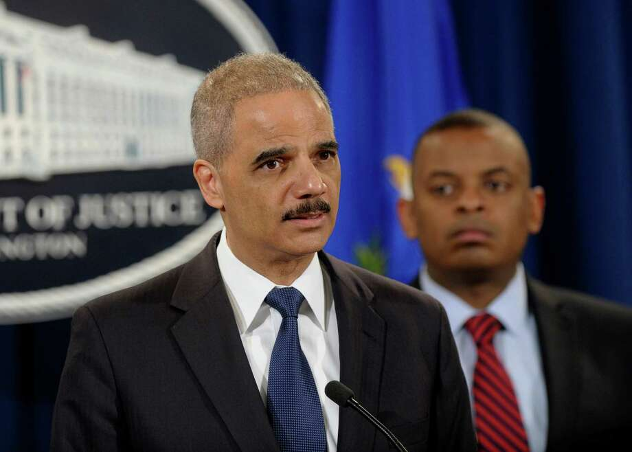 Attorney General Eric Holder, left, accompanied by Transportation Secretary Anthony Foxx, announces a $1.2 billion settlement with Toyota over its disclosure of safety problems, Wednesday, March 19, 2014, during a news conference at the Justice Department in Washington. (AP Photo/Susan Walsh) Photo: Susan Walsh, STF / AP
