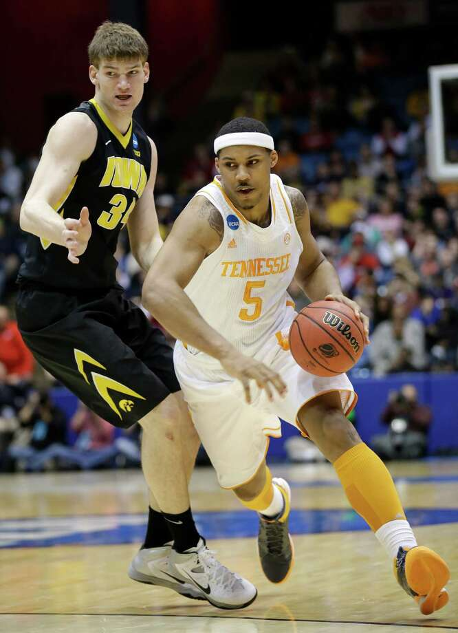 Tennessee forward Jarnell Stokes (5) drives around Iowa center Adam Woodbury (34) in the first half of a first-round game of the NCAA college basketball tournament on Wednesday, March 19, 2014, in Dayton, Ohio. (AP Photo/Al Behrman) ORG XMIT: OHAB130 Photo: Al Behrman / AP