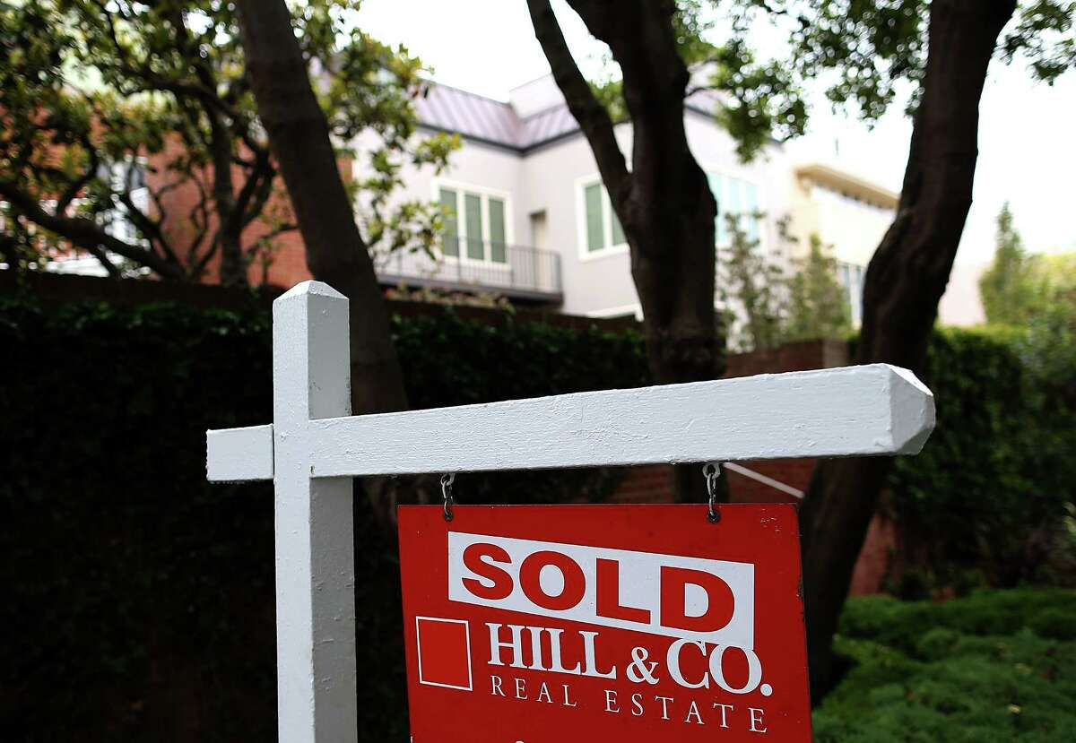 According to reports, US existing home sales fell in January to its lowest level since July 2012. A sold sign is posted in front of a home for sale on July 30, 2013 in San Francisco, California. According to the S&P/Case Shiller composite index survey of 20 metropolitan areas, home prices increased 2.4 percent in May, their highest level since 2006. San Francisco home prices skyrocketed 24.5 percent.
