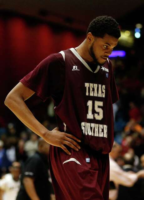 Texas Southern's D'Angelo Scott walks off the court after falling to Cal Poly, which has a losing record. The Tigers are 0-5 in the NCAAs. Photo: Gregory Shamus / Getty Images / 2014 Getty Images
