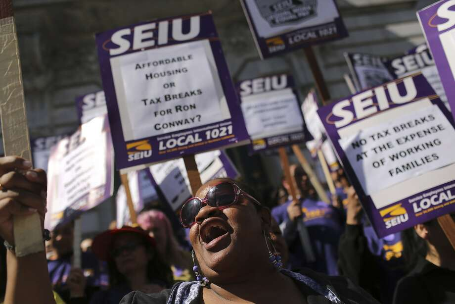SEIU members make a showing at events such as a City Hall protest in March against tax breaks for tech firms. Photo: Robert Galbraith, Reuters